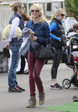 Naomi Watts shopped at the Brentwood Farmers Market in a denim jacket, wine-colored denim, and beige Nike sneakers with funky purple laces.