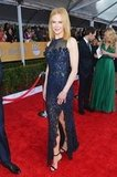 Nicole Kidman got glam in a navy Vivienne Westwood couture collumn dress.