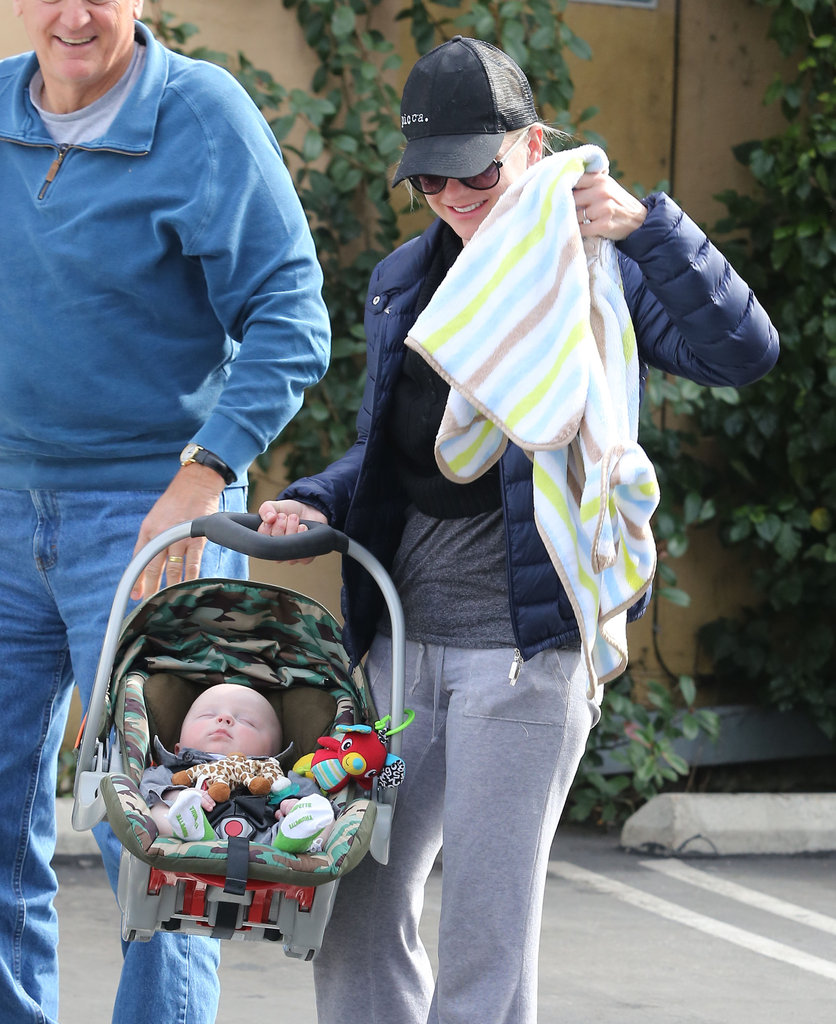 Anna Faris held on to her baby son, Jack, in his car seat.