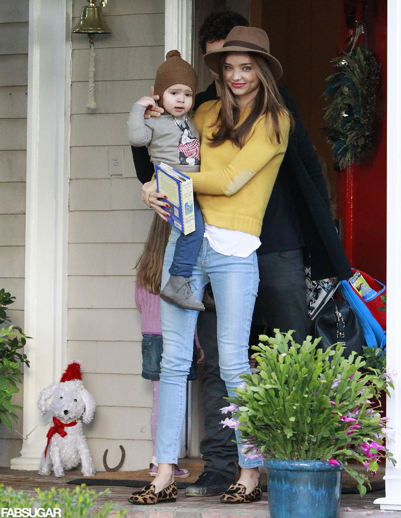 Miranda celebrated the holidays with baby Flynn in a pair of light-wash Frame Denim jeans, which she styled with a bright yellow Boy. by Band of Outsiders sweater and a boho-chic Rag & Bone hat.