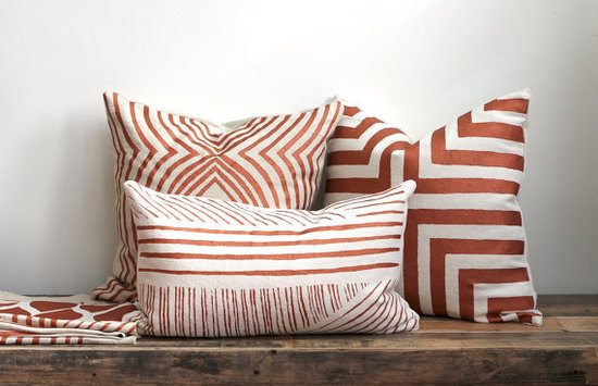 Use these metallic-red pillows ($65 each) to incorporate rustic copper tones into your space.