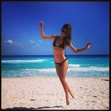 Miranda Kerr hit the beach in a black bikini during a trip to Mexico. Source: Instagram user mirandakerrverified