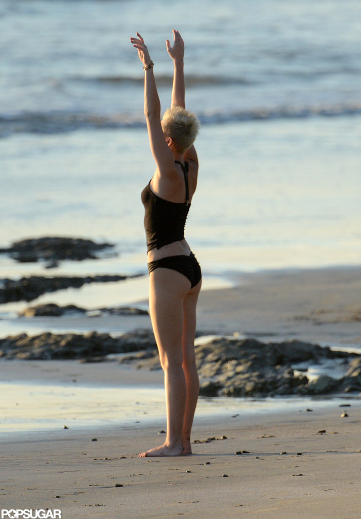 Miley Cyrus did yoga poses on the beach in Costa Rica.