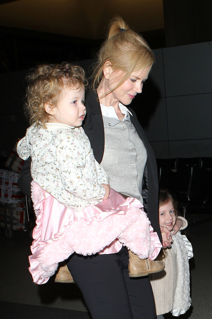 Nicole Kidman had her daughters Faith Urban and Sunday Urban with her as she flew out of LAX.