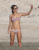 Alessandra Ambrosio took pictures of herself on the beach.