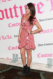 Shay Mitchell showed off a red print ruffle dress with a bevy of bracelets and black booties at a Juicy Couture fragrance launch in LA. She reminds us that sexy can be playful too.