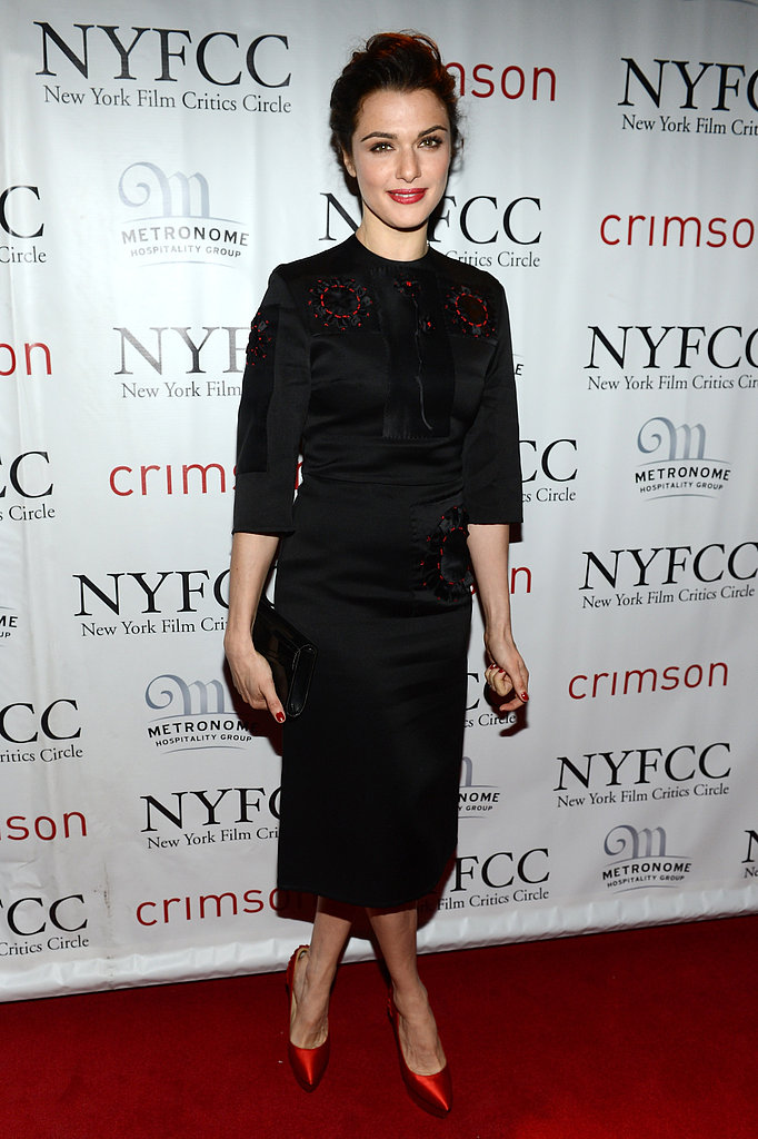 Rachel Weisz was demure in a black midi dress and red satin pumps at the 2012 New York Film Critics Circle Awards. While we love red leather or suede pumps, red satin pumps are that much more fabulous.