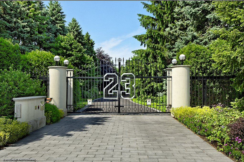 A symbol of Jordan's success, his 23 uniform number greets guests as they enter the gates of his eight-acre property.