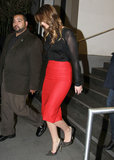 Jennifer Lawrence changed into a red skirt and sheer blouse.