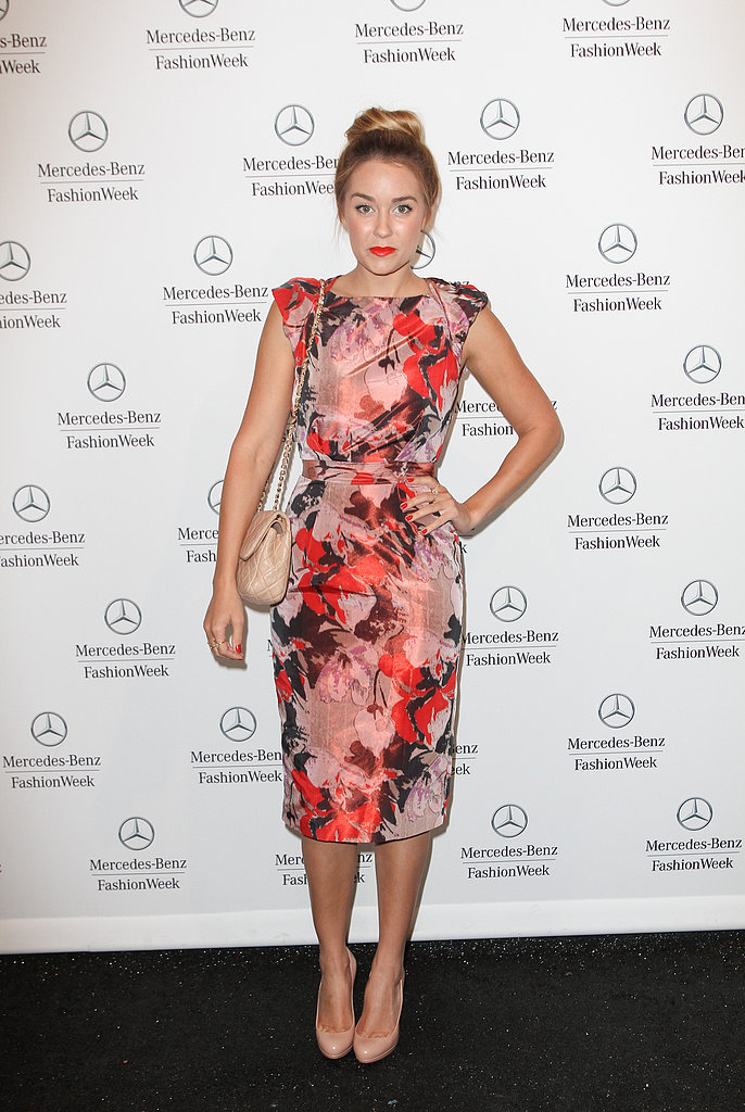 While you might think floral is only reserved for when the sun's out, Lauren Conrad shows us differently. Try a dress with an equally striking print and color — it's not only feminine and polished, but also playful enough to take you to the the bar or a local gallery. Top off the look with nude accessories that complement.