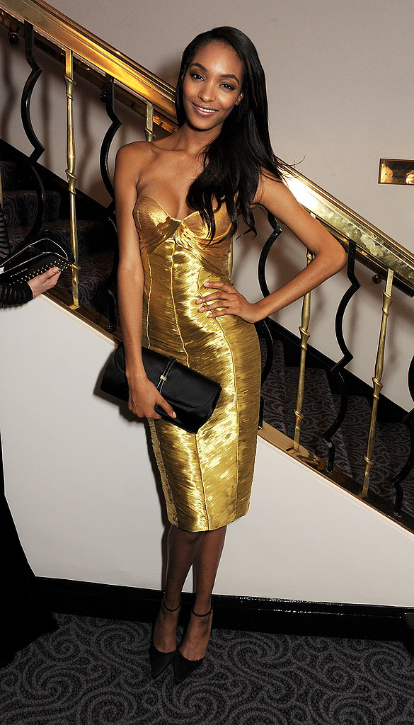 Jourdan Dunn doubled up on shine and glamour in a strapless gold Burberry number at the 58th London Evening Standard Theatre Awards. The model balanced her glitzy look with black ankle-strap pumps and a satin clutch, also by Burberry.