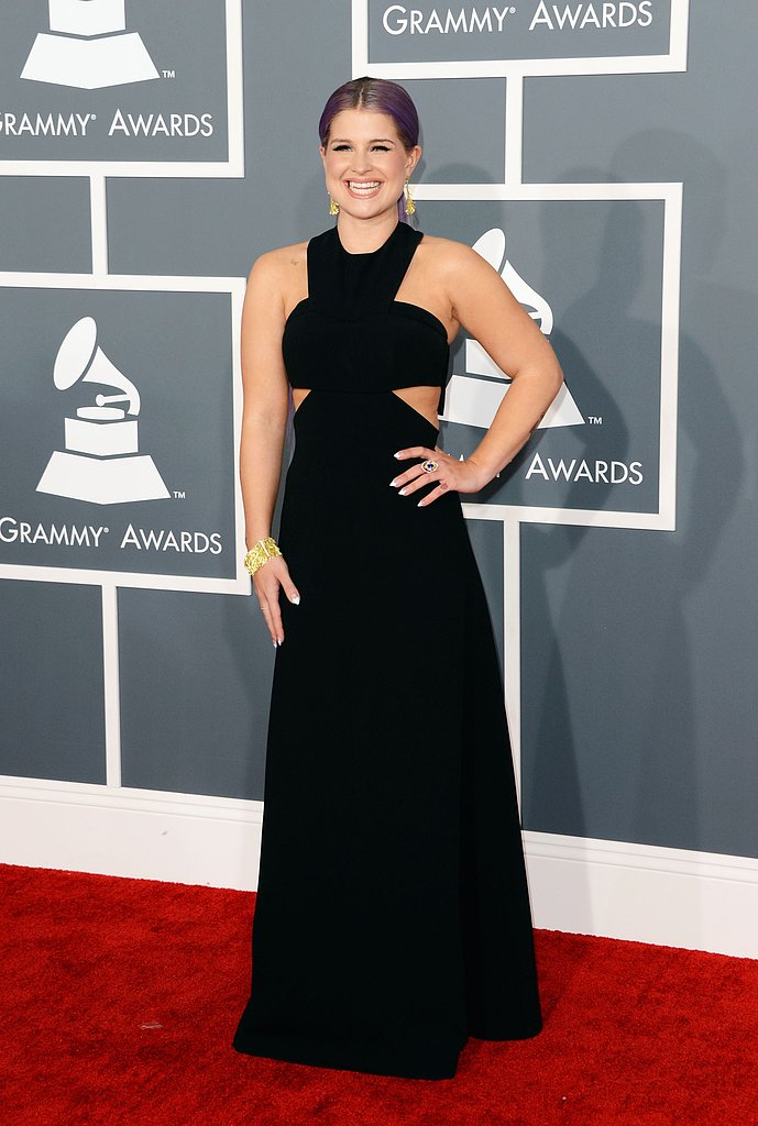 Kelly Osbourne was all smiles on the Grammys red carpet.