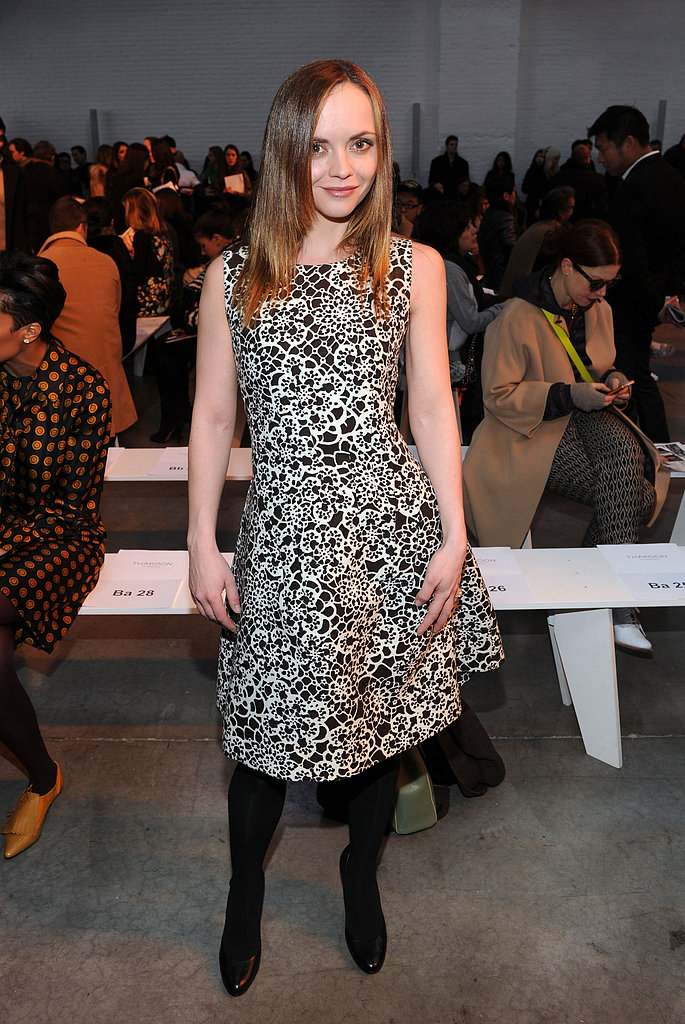 Posing front row at Thakoon, Christina Ricci sported a black-and-white print dress with black opaque tights and patent pumps.
