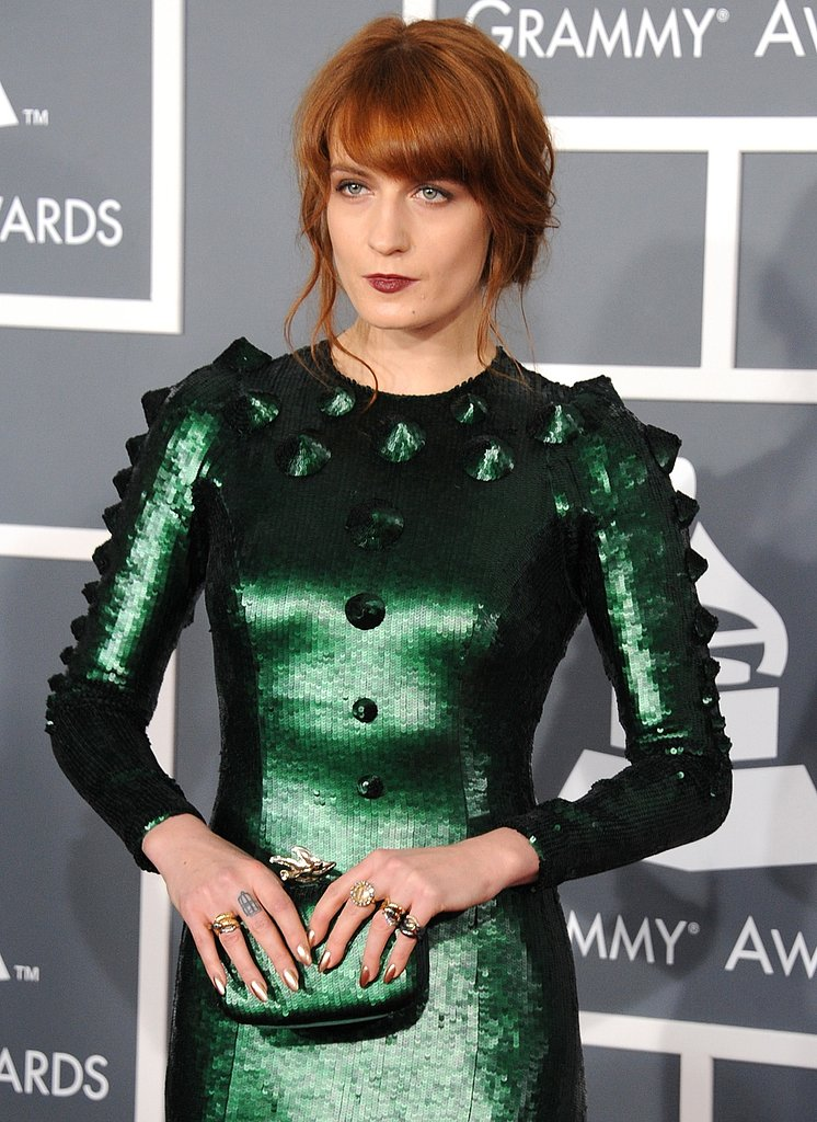 Florence Welch's emerald-green clutch and bevy of sparkly rings added major flair to her custom-made Givenchy gown.