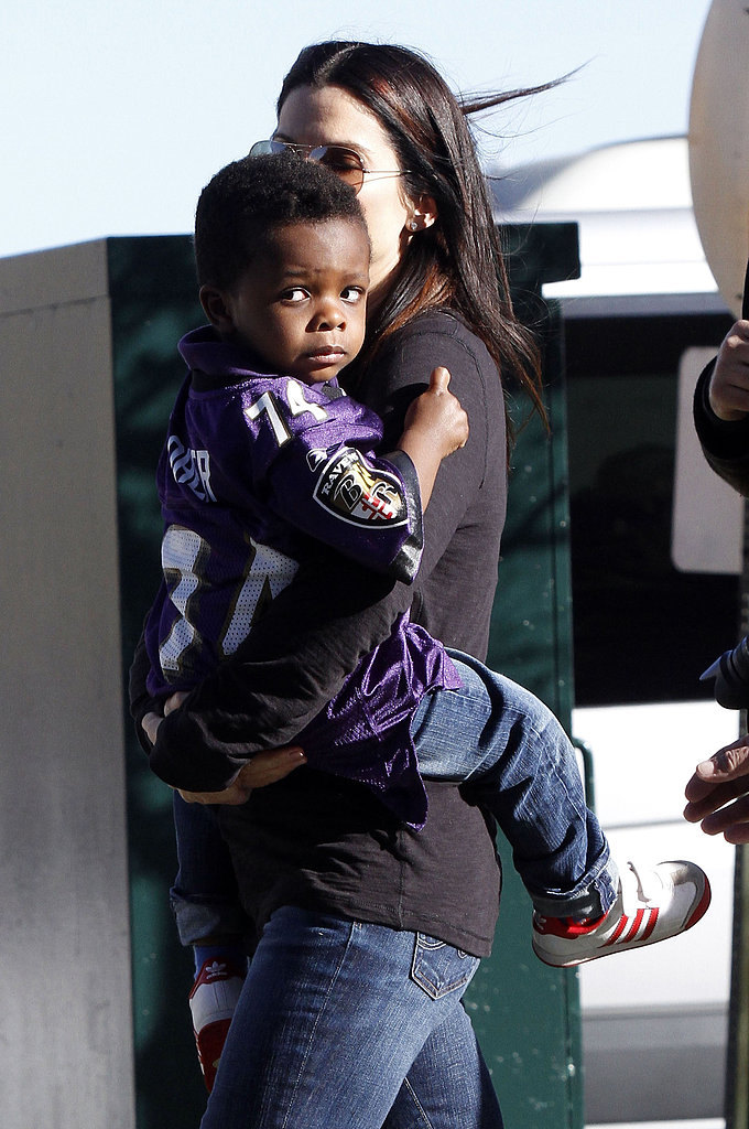 Sandra Bullock carried Louis into the Superdome on Super Bowl Sunday.