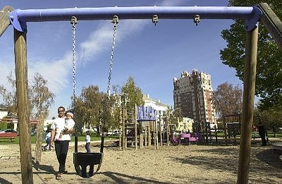 Adult Man Gets Stuck in Children's Swing at Playground