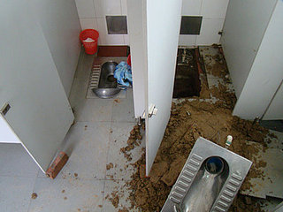 Newborn Falls Down Toilet Pit After Surprise Birth