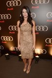 Ashley Greene chose a one-shouldered gold Monique Lhuillier confection, complete with classic round-toe nude pumps, for her appearance at the Audi Super Bowl party.