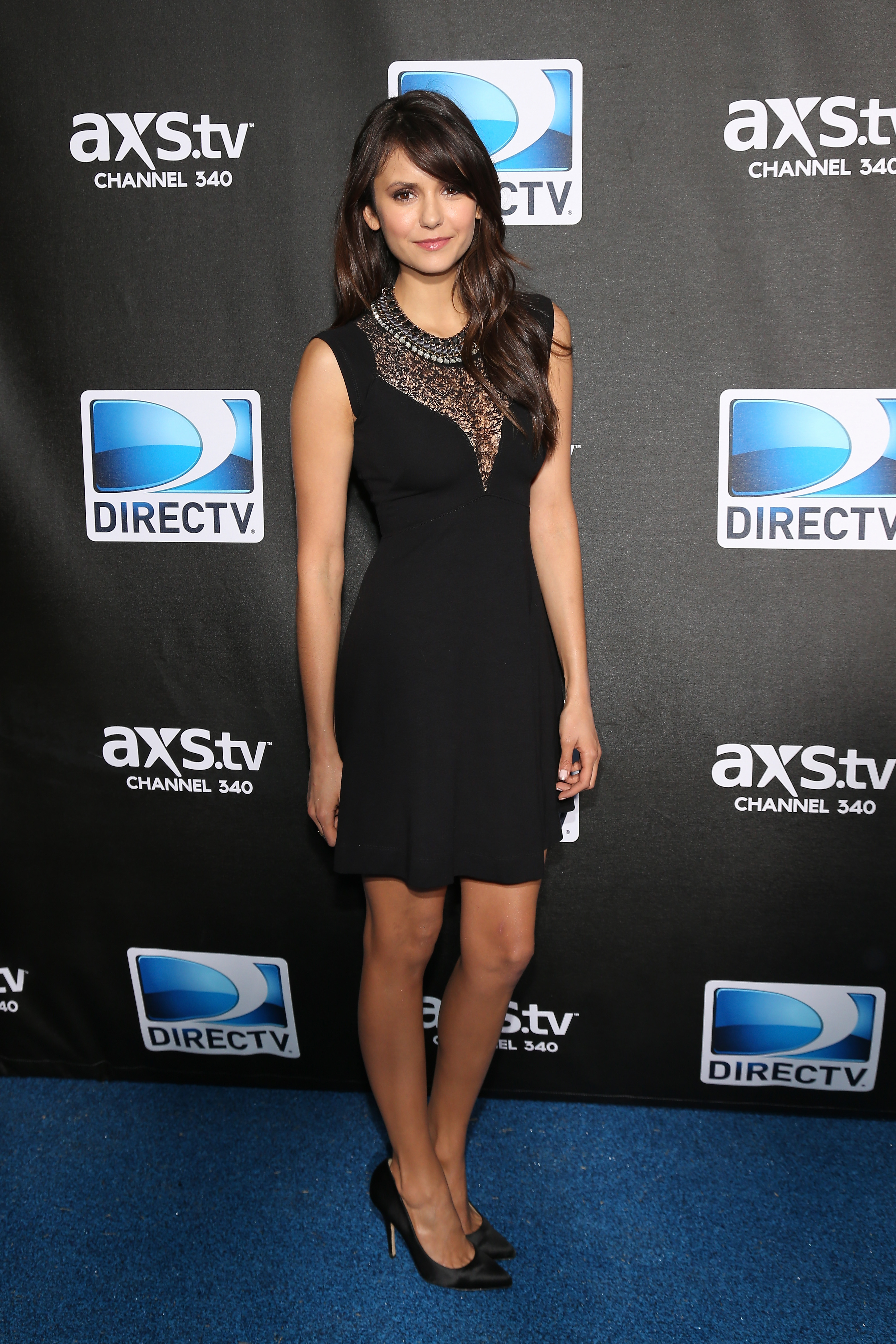 Nina Dobrev slipped into something a little darker than her earlier Zuhair Murad fare for DirecTV's Super Saturday Night party. She chose