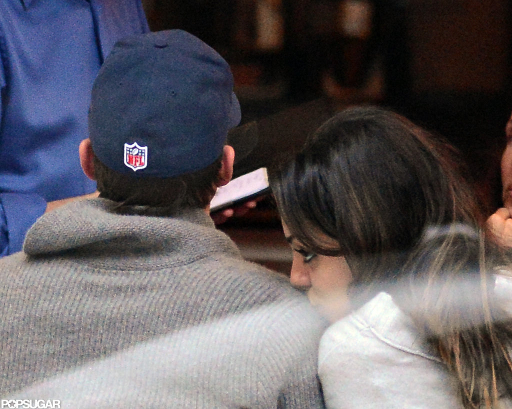 Mila Kunis kissed Ashton Kutcher's shoulder during a dinner date in NYC in November 2012.