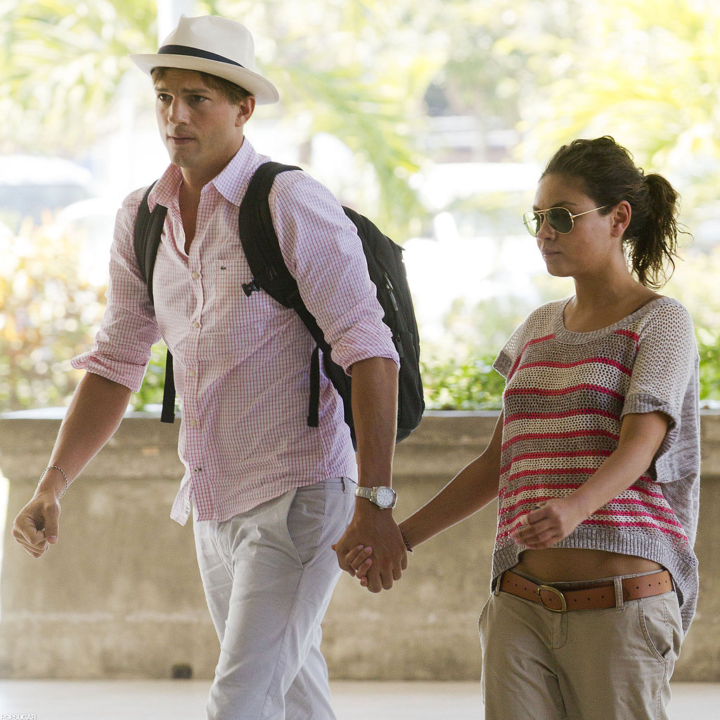 Ashton and Mila held hands while walking through Bali's airport in August 2012 after a PDA-filled vacation.