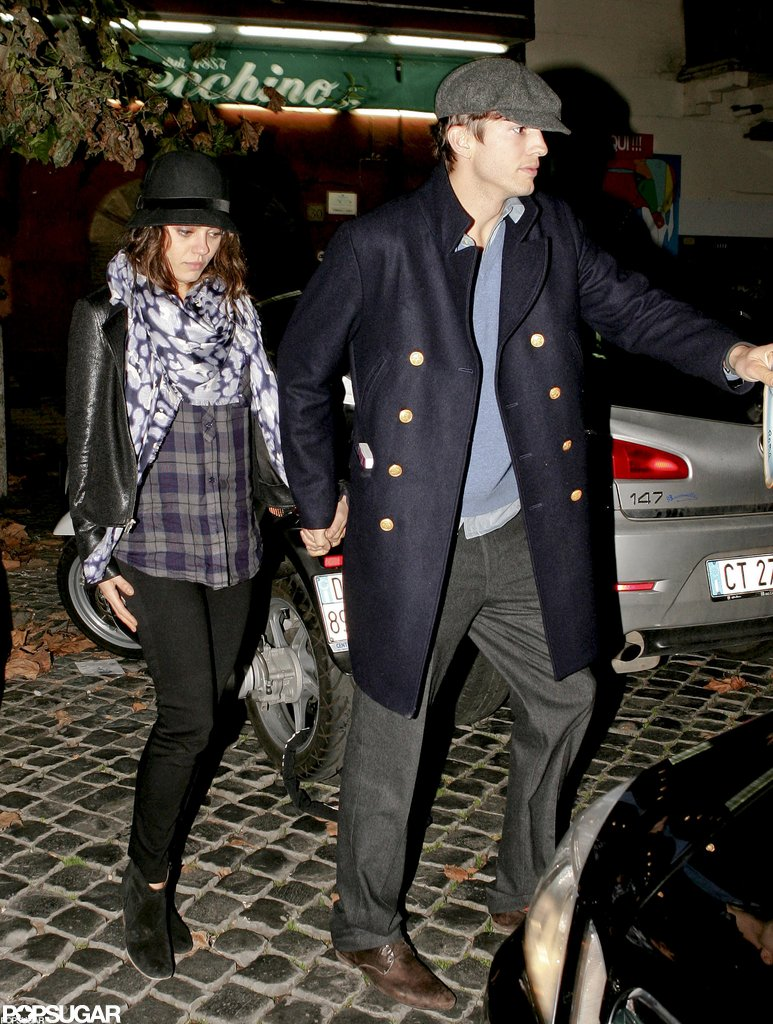 Ashton Kutcher led the way as he and girlfriend Mila Kunis went to dinner in Rome in November 2012.