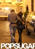Ashton Kutcher and Mila Kunis cuddled up to keep warm while exploring Rome together in November 2012.