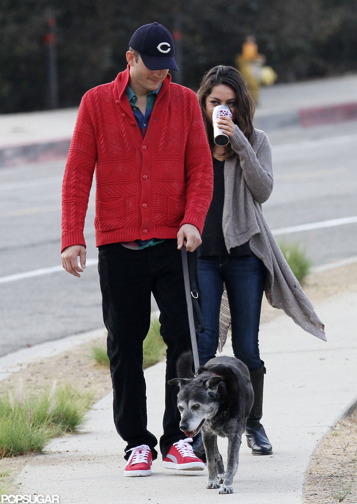 Ashton Kutcher and Mila Kunis took their dog for an early-morning walk in LA in October 2012.