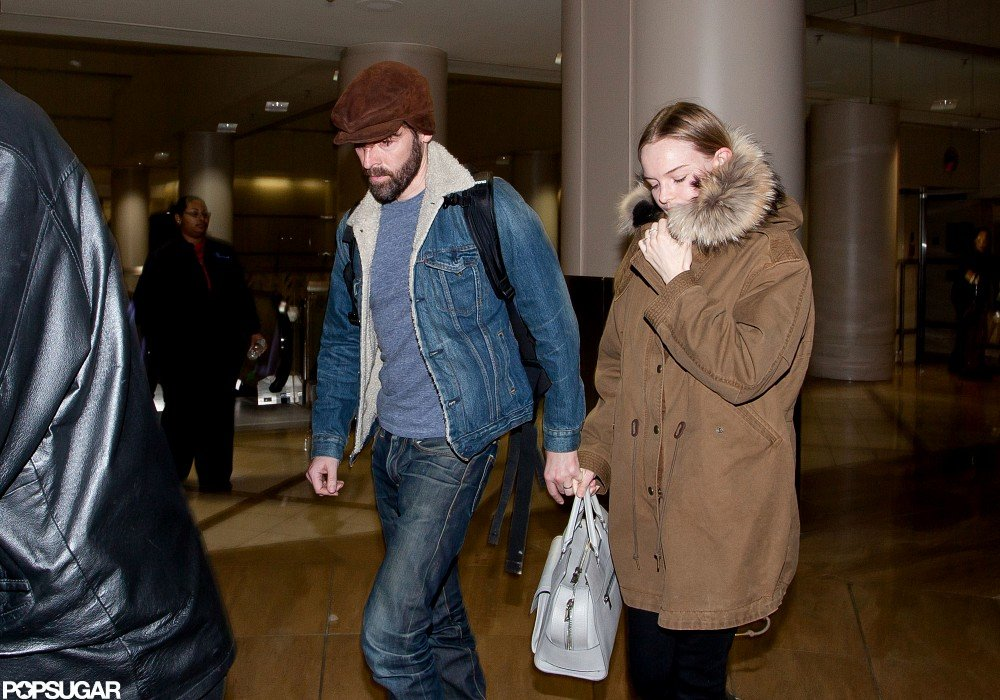 Kate Bosworth and Michael Polish touched down at LAX hand in hand.