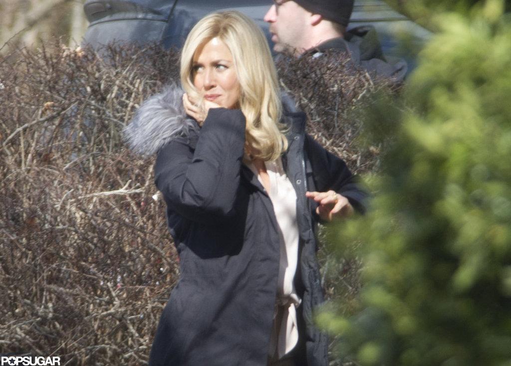 Jennifer Aniston kept warm in a black parka.