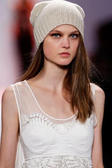 "The light, wispy, sideswept hair then got tucked under folded hats. ""It reminds me of a Turkish men's hat,"" Philippon said of the look."