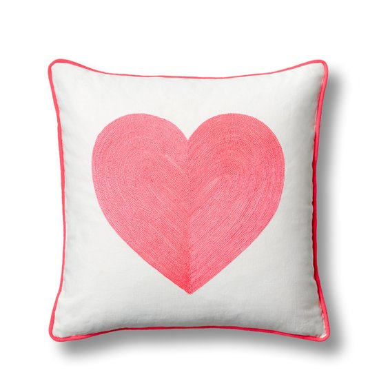A punchy pink shade gives this neon heart pillow cover ($38) a fresh, modern look.