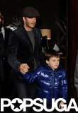 Cruz held on to dad David Beckham Friday night in London.