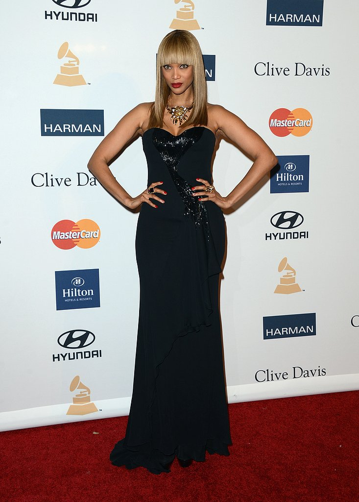 Tyra Banks stepped out in a strapless sequin gown and diamond statement necklace.
