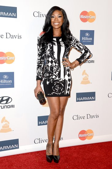The black-and-white minidress Brandy chose for Clive Davis's bash was right on point.