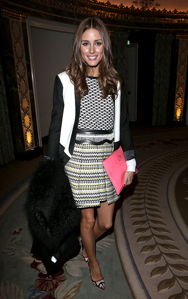 Olivia Palermo mixed prints with ease at Temperley London's collection. Up top she sported a geometric print Tibi sweater, while on bottom it was all about her zig-zag Milly skirt.