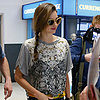 Celebrity Pictures: Miranda Kerr At LAX In Jeans, Sunglasses