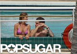 Jennifer soaked up the sun with then-boyfriend John Mayer in a Miami pool in May 2008.