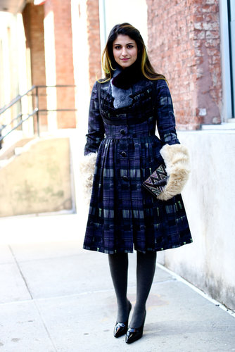 This show-goer paired a fit-and-flare dress with the coziest of mittens for an unexpectedly sweet style.