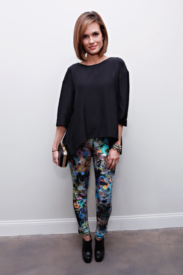 The Vampire Diaries star Torrey DeVitto punched up her black sweater and booties with colorful floral pants at Cynthia Rowley.