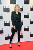 Rosamund Pike ditched the gown for a slim-fitting tuxedo suit and a Smythson envelope clutch at the Elle Style Awards.