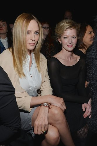 Uma Thurman was prim and polished in neutrals sitting front row with Gretchen Mol at Donna Karan New York.