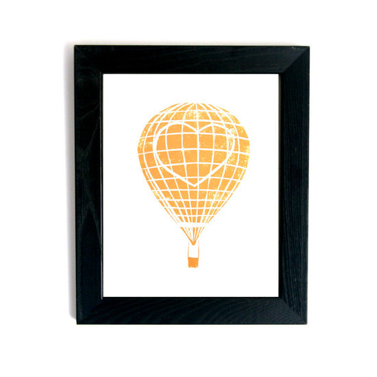 This unique heart hot air balloon print ($30) will add sweet style to the space.