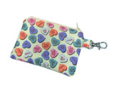 "Conversation hearts go rogue in this zipper pouch ($10) with sayings like ""loser,"" ""you wish,"" and ""be my ex."""