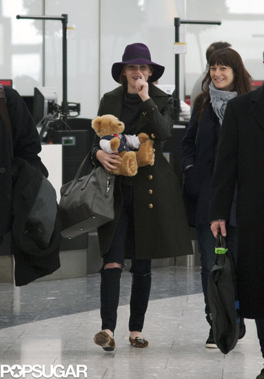 Jennifer Lawrence carried a teddy bear while making her way through Heathrow Airport near London.