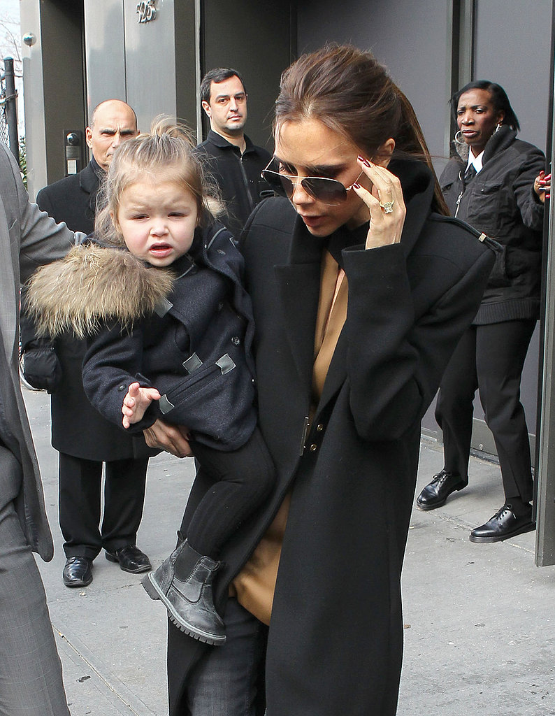 Victoria Beckham carried Harper during NY Fashion Week in February.