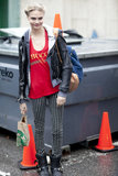Cara Delevingne worked the '90s grunge angle in a pair of striped pants and biker boots.
