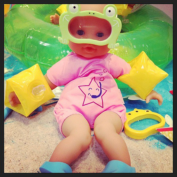 This Corolle baby doll is bathtub-ready in her frog goggles and flippers.