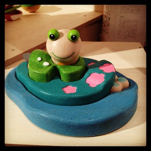 Plan Toys's Frog Life Puzzle starts with little frog eggs and builds up to the full-size frog.