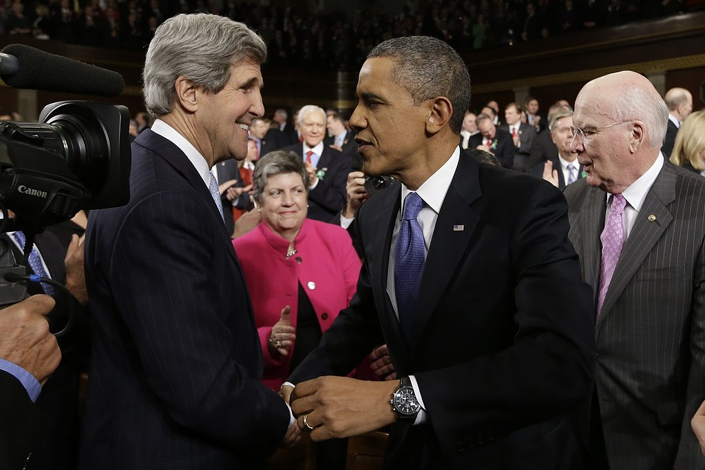 The president greeted his new secretary of state, John Kerry.